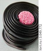 Купить «Спираль лакричного жевательного мармелада», фото № 3049772, снято 19 ноября 2007 г. (c) Monkey Business Images / Фотобанк Лори