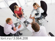 Купить «Четыре деловых человека в переговорной комнате за работой с документами», фото № 3064208, снято 29 октября 2006 г. (c) Monkey Business Images / Фотобанк Лори