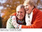 Купить «Пожилая пара обнимается и смеется», фото № 3073520, снято 12 ноября 2008 г. (c) Monkey Business Images / Фотобанк Лори