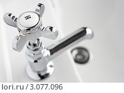Купить «Кран с горячей водой на раковине (крупный план)», фото № 3077096, снято 19 ноября 2008 г. (c) Monkey Business Images / Фотобанк Лори