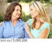 Купить «Взрослая дочь разговаривает с матерью, обнимает за плечи», фото № 3089268, снято 11 августа 2009 г. (c) Monkey Business Images / Фотобанк Лори