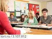 Купить «Учитель со старшеклассниками на уроке», фото № 3107812, снято 18 февраля 2010 г. (c) Monkey Business Images / Фотобанк Лори