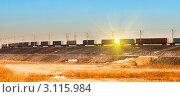 Купить «Грузовой состав на фоне солнца и голубого безоблачного неба», фото № 3115984, снято 4 января 2012 г. (c) Андрей Пашков / Фотобанк Лори