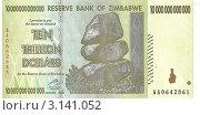 Купить «Десять триллионов долларов.Банкнота Зимбабве.», фото № 3141052, снято 7 ноября 2011 г. (c) Кургузкин Константин Владимирович / Фотобанк Лори