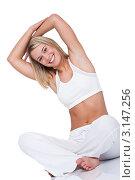 Купить «Портрет молодой блондинки в белом, делает зарядку, сидя на полу», фото № 3147256, снято 3 апреля 2009 г. (c) CandyBox Images / Фотобанк Лори