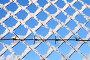 Фрагмент забора с колючей проволокой, фото № 3149728, снято 16 января 2012 г. (c) Икан Леонид / Фотобанк Лори