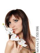 Купить «Красивая девушка с цветком орхидеи», фото № 3150996, снято 6 января 2012 г. (c) ElenArt / Фотобанк Лори