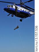 Купить «Сотрудник ОМОН десантируется с вертолёта», эксклюзивное фото № 3157536, снято 14 октября 2011 г. (c) Free Wind / Фотобанк Лори
