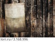 Купить «Старый лист бумаги на деревянной поверхности. Гранж», фото № 3168996, снято 20 октября 2009 г. (c) vlntn / Фотобанк Лори
