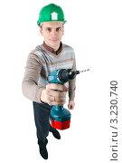 Молодой рабочий  с электрической дрелью в руке. Стоковое фото, фотограф Дмитрий Поляков / Фотобанк Лори
