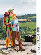 Купить «Двое туристов стоят на вершине горы и смотрят вдаль», фото № 3251408, снято 16 июня 2011 г. (c) CandyBox Images / Фотобанк Лори