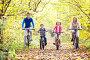 Семья из четырех человек катается на велосипедах в осеннем парке, фото № 3252480, снято 8 октября 2011 г. (c) Raev Denis / Фотобанк Лори
