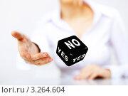 Купить «Человек кидает черный кубик с надписями no и yes», фото № 3264604, снято 25 марта 2019 г. (c) Sergey Nivens / Фотобанк Лори
