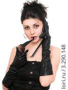 Купить «Девушка в черной одежде разговаривает по сотовому телефону», фото № 3290148, снято 28 марта 2010 г. (c) Сергей Сухоруков / Фотобанк Лори