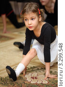 Купить «Девочка в чёрной гимнастической майке и тапочках выполняет упражнение на ковре», фото № 3299548, снято 25 ноября 2010 г. (c) Losevsky Pavel / Фотобанк Лори