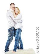 Купить «Веселая молодая пара в джинсах и белых рубашках танцует на меховом коврике», фото № 3300156, снято 4 апреля 2010 г. (c) Losevsky Pavel / Фотобанк Лори