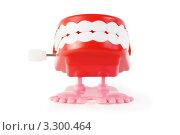 Купить «Детская игрушка: заводные зубы на белом фоне», фото № 3300464, снято 28 сентября 2010 г. (c) Losevsky Pavel / Фотобанк Лори