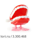 Купить «Игрушечные заводные зубы на белом фоне», фото № 3300468, снято 28 сентября 2010 г. (c) Losevsky Pavel / Фотобанк Лори
