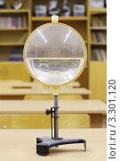 Купить «Старая водяная линза на столе в школьном кабинете физики», фото № 3301120, снято 14 октября 2010 г. (c) Losevsky Pavel / Фотобанк Лори
