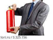Купить «Мужчина с огнетушителем на сером фоне, фрагмент», фото № 3325156, снято 19 апреля 2019 г. (c) Elnur / Фотобанк Лори