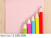Купить «Цветные карандаши на розовой бумаге», фото № 3338008, снято 2 марта 2012 г. (c) Sea Wave / Фотобанк Лори