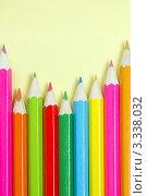 Купить «Цветные карандаши на желтом фоне», фото № 3338032, снято 2 марта 2012 г. (c) Sea Wave / Фотобанк Лори