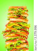 Купить «Огромный сандвич на  зеленом фоне», фото № 3379996, снято 5 апреля 2009 г. (c) Elnur / Фотобанк Лори