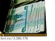 Пачка банкнот 1000 рублей в ящике кассы. Стоковое фото, фотограф Vladimir Shashkin / Фотобанк Лори
