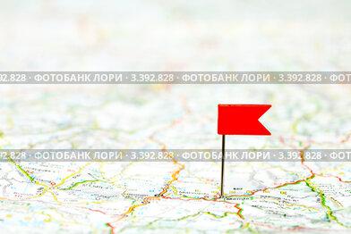 Булавка в виде красного флажка на карте
