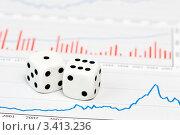 Купить «Две белых игральных кубика лежат на финансовых диаграммах», фото № 3413236, снято 23 ноября 2008 г. (c) Дмитрий Наумов / Фотобанк Лори