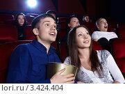Купить «Молодые люди в кинотеатре», фото № 3424404, снято 27 февраля 2012 г. (c) Raev Denis / Фотобанк Лори