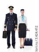 Купить «Стюардесса и пилот с багажом стоят на белом фоне», фото № 3424412, снято 22 сентября 2011 г. (c) Raev Denis / Фотобанк Лори