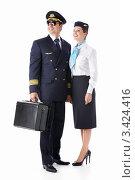 Купить «Мужчина в костюме пилота и девушка в униформе стюардессы», фото № 3424416, снято 22 сентября 2011 г. (c) Raev Denis / Фотобанк Лори
