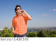 Купить «Молодой человек разговаривает по мобильному телефону на фоне природы», фото № 3430516, снято 25 июня 2008 г. (c) Эдуард Стельмах / Фотобанк Лори