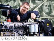 Купить «Механик за работой на фоне из долларовых купюр», фото № 3432668, снято 28 февраля 2008 г. (c) Эдуард Стельмах / Фотобанк Лори