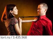 Купить «Девушка тянет за галстук молодого мужчину», фото № 3435968, снято 15 мая 2010 г. (c) Андрей Попов / Фотобанк Лори