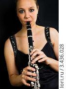 Купить «Девушка играет на кларнете», фото № 3436028, снято 29 мая 2010 г. (c) Андрей Попов / Фотобанк Лори
