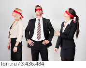 Купить «Мужчина и две девушки с завязанными красной лентой глазами», фото № 3436484, снято 13 ноября 2010 г. (c) Андрей Попов / Фотобанк Лори