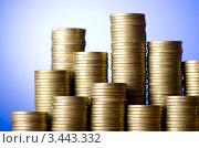 Купить «Стопки из золотых монет на голубом фоне», фото № 3443332, снято 8 декабря 2011 г. (c) Elnur / Фотобанк Лори