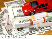Купить «Игрушечный автомобиль на пачках долларов и евро», фото № 3445716, снято 8 ноября 2011 г. (c) ElenArt / Фотобанк Лори