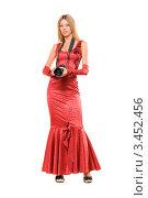 Купить «Блондинка в длинном красном платье с фотокамерой на шее», фото № 3452456, снято 8 сентября 2010 г. (c) Сергей Сухоруков / Фотобанк Лори