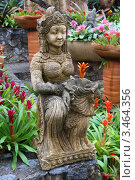 Купить «Керамическая фигура среди цветов и пальм. Тропический сад Нонг Нуч. Паттайя, Таиланд», фото № 3464356, снято 24 марта 2012 г. (c) Григорий Писоцкий / Фотобанк Лори