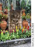 Купить «Изображение Апсары среди цветов и пальм. Тропический сад Нонг Нуч. Паттайя, Таиланд», фото № 3464364, снято 24 марта 2012 г. (c) Григорий Писоцкий / Фотобанк Лори