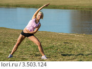 Купить «Девушка занимается гимнастикой на природе», фото № 3503124, снято 21 марта 2012 г. (c) CandyBox Images / Фотобанк Лори