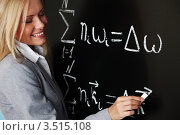 Купить «Учитель пишет математическую формулу на школьной доске», фото № 3515108, снято 15 августа 2010 г. (c) Иван Михайлов / Фотобанк Лори