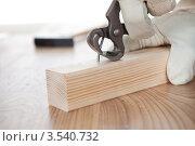 Купить «Кусачками выдирают гвоздь из бруска», фото № 3540732, снято 5 февраля 2012 г. (c) Андрей Попов / Фотобанк Лори