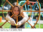 Купить «Молодая девушка на детской площадке», фото № 3549784, снято 20 мая 2012 г. (c) Евгения Плешакова / Фотобанк Лори