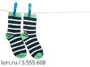 Купить «Разноцветные полосатые носки висят на бельевой веревке», фото № 3555608, снято 16 марта 2012 г. (c) Paleka / Фотобанк Лори