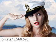 Купить «Сексуальная блондинка в капитанской  фуражке на фоне морского  берега», фото № 3560676, снято 2 июня 2012 г. (c) katalinks / Фотобанк Лори