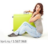 Купить «Девушка думает куда лететь в отпуск», фото № 3567968, снято 23 февраля 2012 г. (c) Сергей Новиков / Фотобанк Лори